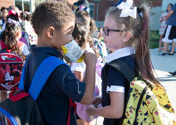 09/03/19 Wesley Bunnell | StaffrrJulian Sherman, L, speaks with his friend and classmate Payton Castiglione while preparing to walk into Smalley School on their first day back on Tuesday September 3, 2019.