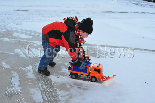 01-21-14 NEWS Eli Plowing Snow