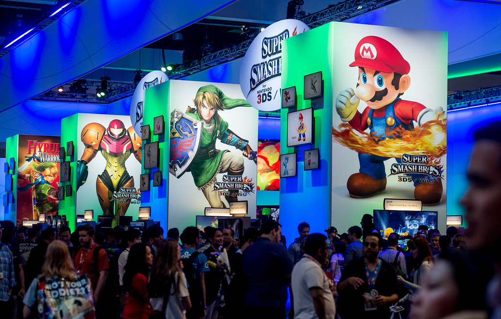 ". Attendees interact with the""Super Smash Bros\"" video game at the Nintendo booth at the Electronic Entertainment Expo in Los Angeles on Tuesday, June 10, 2014. (Photo by Watchara Phomicinda)"