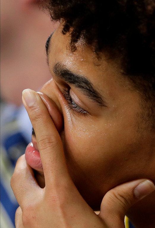 . Michigan\'s Isaiah Livers (4) watches from the bench during the second half in the championship game of the Final Four NCAA college basketball tournament against Villanova, Monday, April 2, 2018, in San Antonio. (AP Photo/Eric Gay)