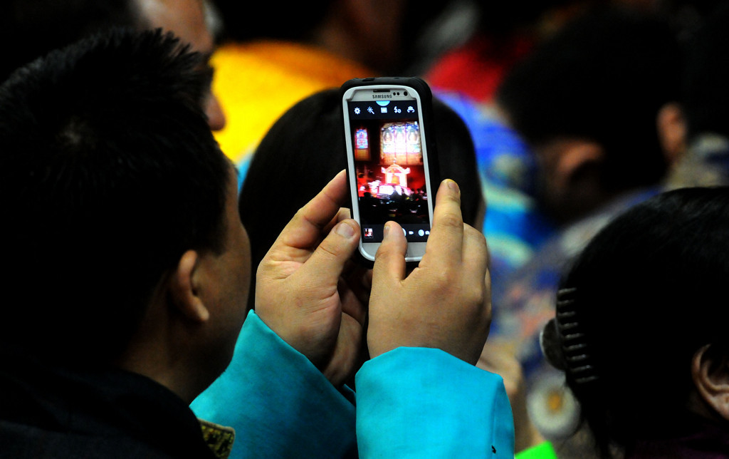 . A man takes cellphone video of the Dalai Lama during his speech. (Pioneer Press: Sherri LaRose-Chiglo)