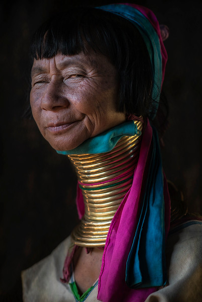 Portrait of a woman from the Kayan tribe wearing the traditional neck rings which have made this tribe famous.  Kayah State, Myanmar 2017.