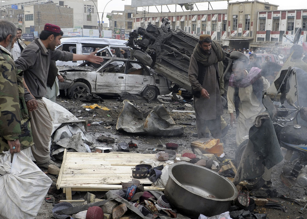 Description of . Debris and mangled vehicles are seen at the site of a bomb explosion in Quetta on January 10, 2013. A bomb attack killed 11 people and wounded dozens more in a crowded part of Pakistan's southwestern city of Quetta, police said. AFP PHOTO/Banaras  KHAN/AFP/Getty Images