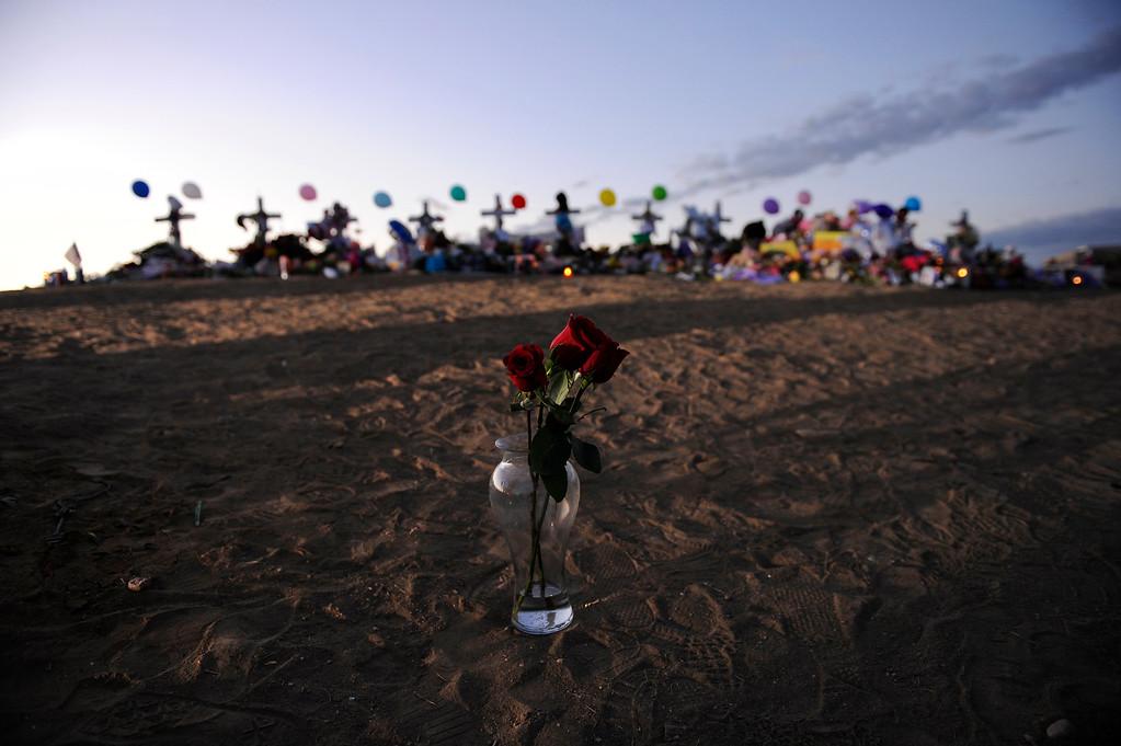 . The sun rises, Thursday, July 26, 2012, over the memorial for shooting victims near the Century Aurora 16 Multiplex. RJ Sangosti, The Denver Post