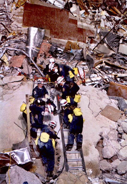 . OKLAHOMA CITY, UNITED STATES:  Rescue workers climb over debris 20 April 1995 at the Albert P. Murrah Federal Building in Oklahoma City, few hours after a fuel-and-fertilizer truck bomb exploded in front of the building. The blast, the worst terror attack on US soil, killed 168 people and injured more than 500. Timothy McVeigh, convicted on first-degree murder charges for the 19 April bombing was sentenced to death in 1997. (AFP/AFP/Getty Images)