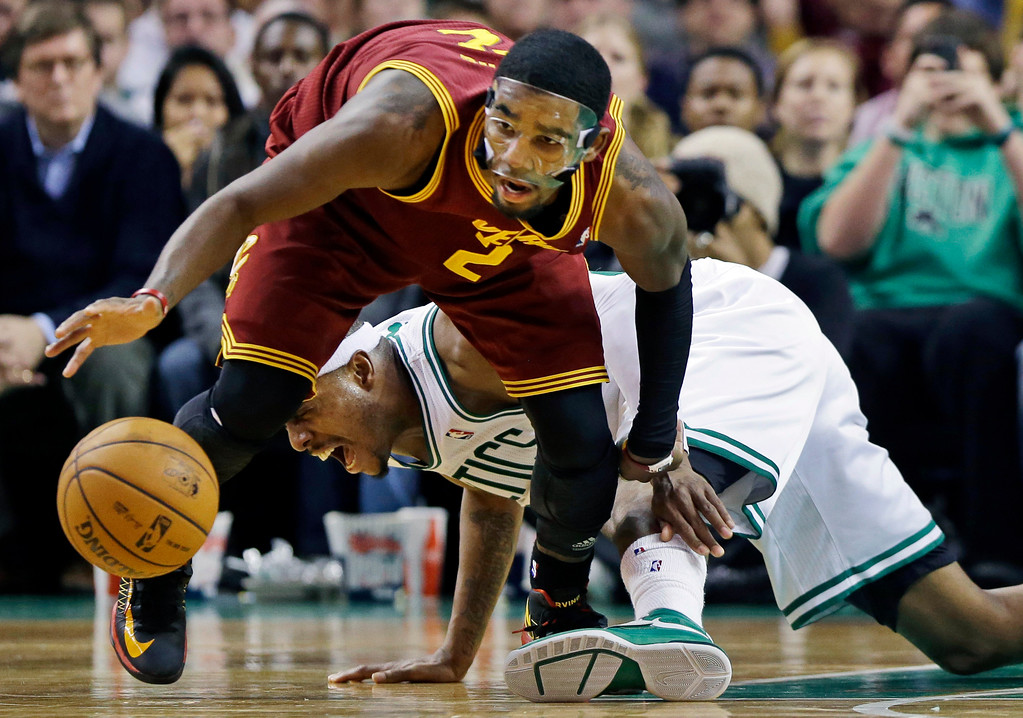 . Cleveland Cavaliers guard Kyrie Irving (2) comes up with a loose ball against Boston Celtics forward Paul Pierce, rear, during the second half of an NBA basketball game in Boston, Wednesday, Dec. 19, 2012. The Celtics won 103-91. (AP Photo/Elise Amendola)
