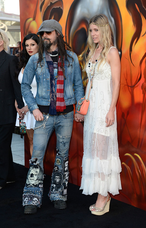 . Rob Zombie and Sheri Moon Zombie arrives at the 5th Annual Revolver Golden Gods Award Show  at Club Nokia on May 2, 2013 in Los Angeles, California.  (Photo by Frazer Harrison/Getty Images)