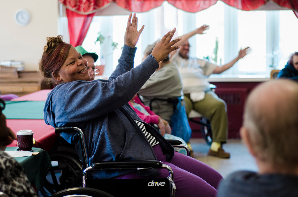 . Connie Dowdle joins in an exercise class at the Fitchburg Gardens on April 14, 2017. SENTINEL & ENTERPRISE / Ashley Green