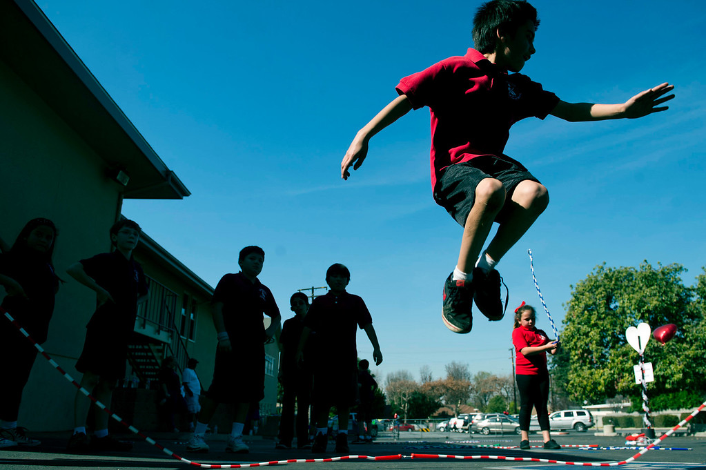 . Luke Moreno, 9, plays jumprope during an exercise at Plymouth Christian School in Whittier on Friday, Feb. 14, 2014. The school held the exercise event to promote good health. (Photo by Watchara Phomicinda/ Whittier Daily News)