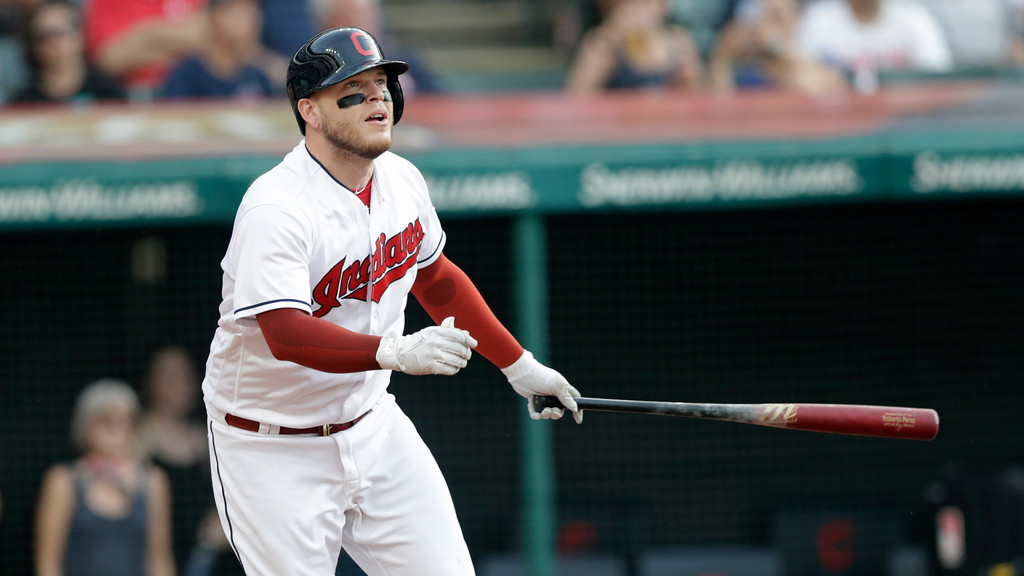 . Cleveland Indians\' Roberto Perez watches his ball after hitting a ground rule double off Chicago White Sox starting pitcher Dylan Covey in the second inning of a baseball game, Monday, June 18, 2018, in Cleveland. Lonnie Chisenhall and Rajai Davis scored on the play. (AP Photo/Tony Dejak)