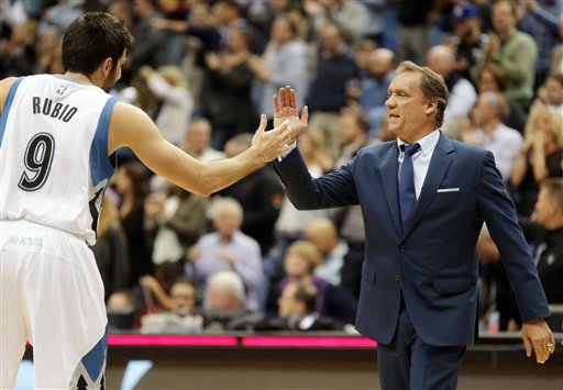 . Minnesota Timberwolves\' Ricky Rubio, left,  of Spain, and head coach Flip Saunders celebrate after the Timberwolves beat the Detroit Pistons 97-91 in a NBA basketball game, Thursday, Oct. 30, 2014, in Minneapolis. (AP Photo/Jim Mone)