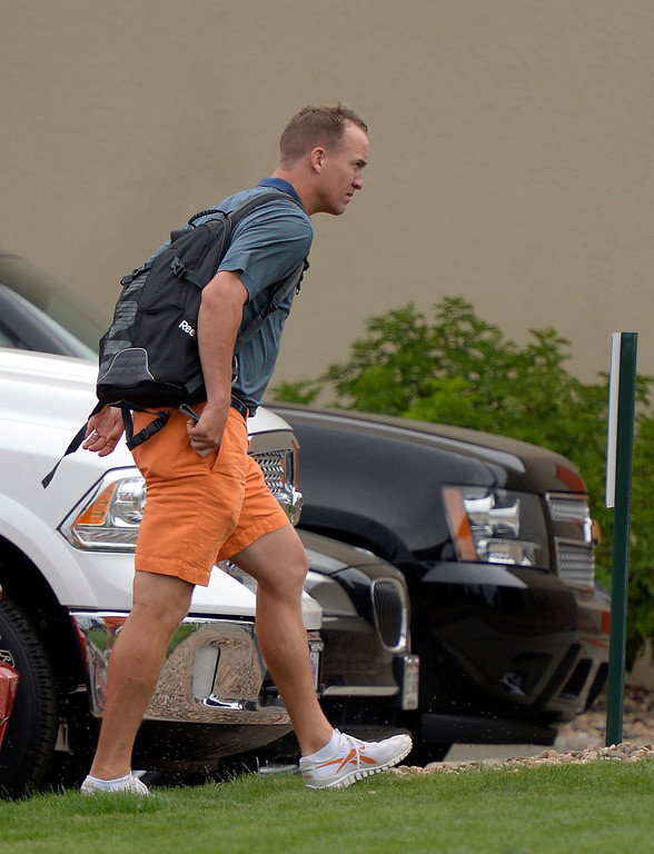 . Denver Broncos quarterback Peyton Manning exits his car as he reports to camp July 24, 2013 at Dove Valley. The players had physicals at the teams headquarters. (Photo By John Leyba/The Denver Post)