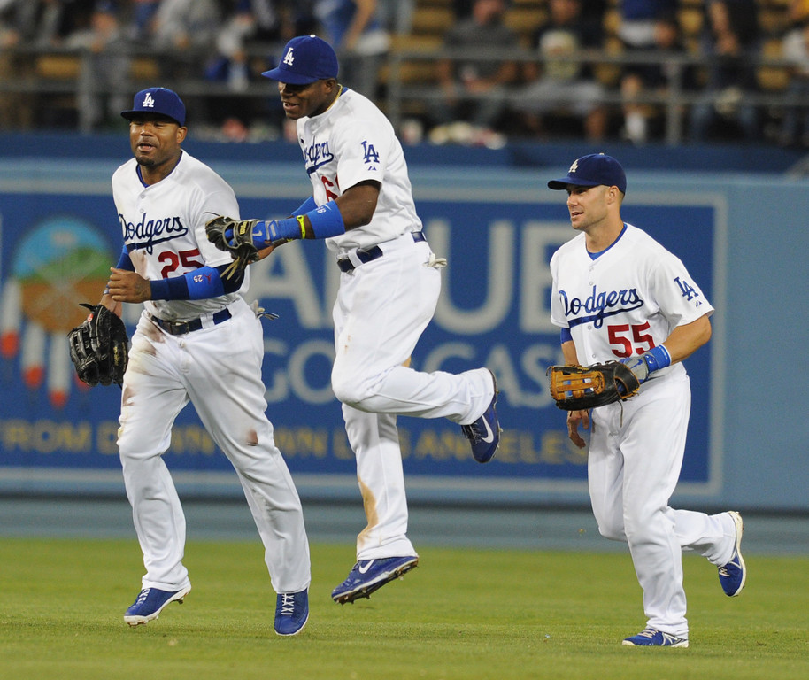 . Dodgers Carl Crawford Yasiel Puig and Skip Schumaker at the end of the game. The Dodgers defeated the New York Mets  4-2 in a game at Dodger Stadium in Los Angeles, CA. 8/13/2013(John McCoy/LA Daily News)