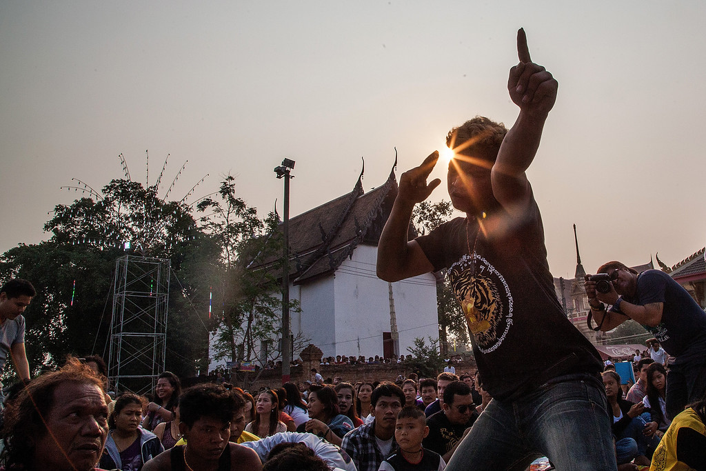 . A tattooed Thai devotee enters in state of trance during sunrise as he tries to pay his respect to a statue of Khru Sak during the celebration of the annual Tattoo festival at Wat Bang Phra on March 15, 2014 in Nakhon Pathom, Thailand.   (Photo by Omar Havana/Getty Images)