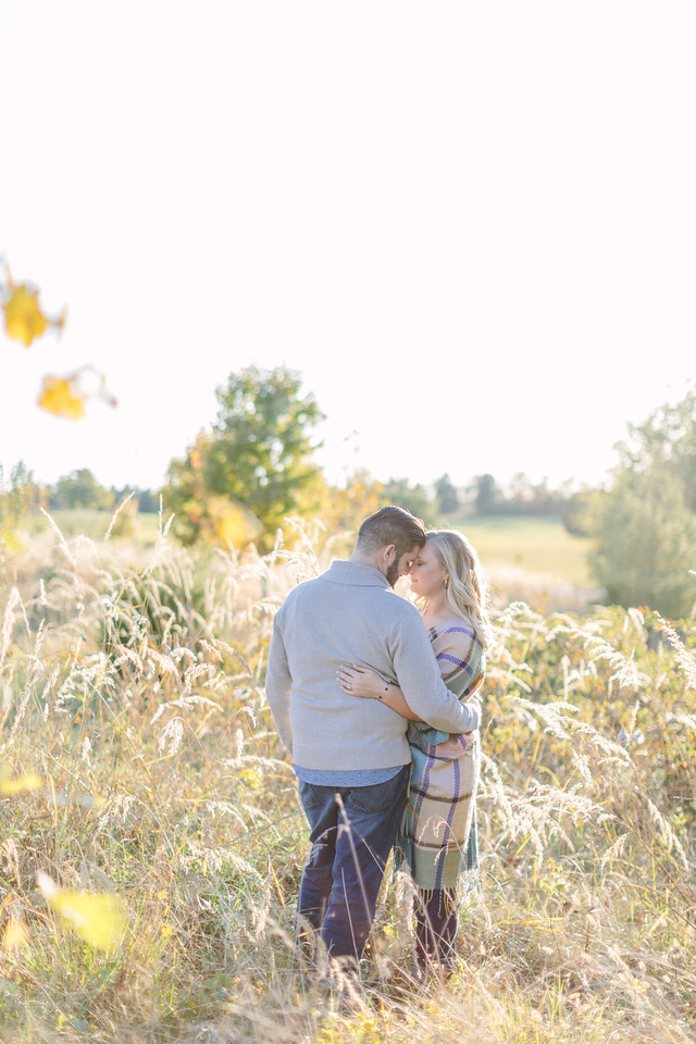 Field engagement session in Virginia. Alli wore a poncho. Chris wore a sweater.