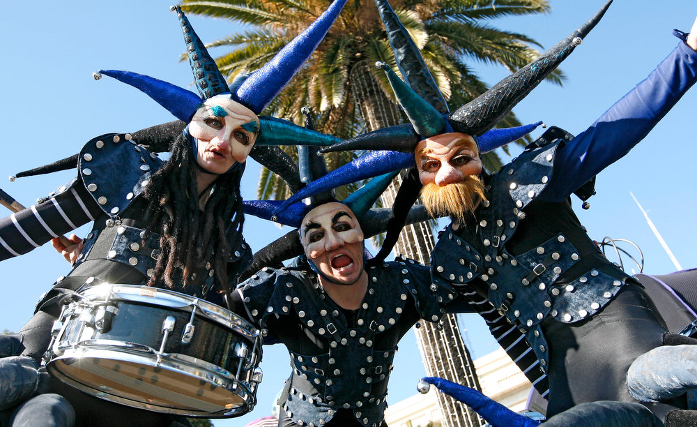 Description of . Revelers parade during the flower parade of the 129th edition of the Nice Carnival, Saturday, Feb. 16, 2013, in Nice, southern France. The carnival celebrates the theme
