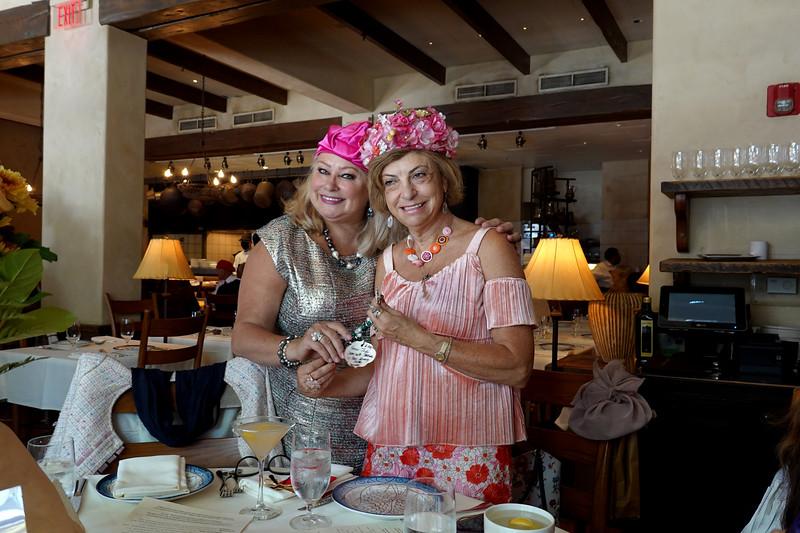 (L-R) Irina Nudelman with her birthday gift to Ludmila Kisseleva-Eggleton