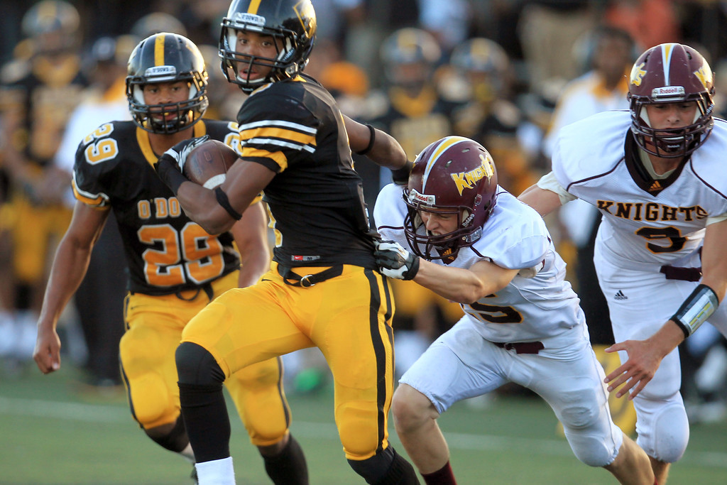 . <p>6. KEVIN KING � DEFENSIVE BACK � BISHOP O\'DOWD</p> King (5) scrambles against Las Lomas\' Wyatt Horner (15) in the first quarter during a non-league game at Bishop O\'Dowd football field in Oakland, Calif., on Friday, August 24, 2012. (Ray Chavez/Staff)
