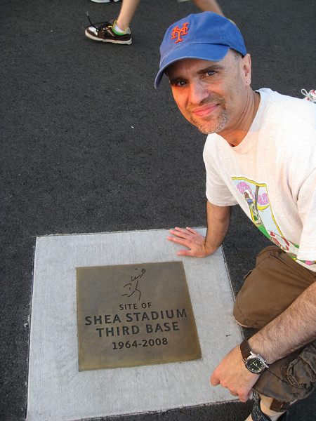 My brother in law posing in front of the exact location third base resided at Shea Stadium which is now part of the parking lot of Citi field.
