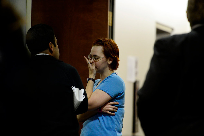 . People arrive take a break from the hearing for James Holmes at the Arapahoe County Justice Center on Tuesday, January 8, 2012. AAron Ontiveroz, The Denver Post