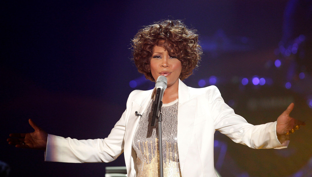 ". Singer Whitney Houston performs during the German game show  ""Wetten Dass...?\""  (Bet it...?)  in Freiburg, southwestern Germany, Saturday, Oct. 3, 2009.   (AP Photo/Johannes Eisele, Pool)"
