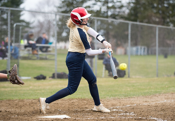 04/11/19 Wesley Bunnell | Staff New Britain softball defeated Newington on the road 4-1 on Thursday afternoon. Rachel Thureson (10) makes contact for a double.