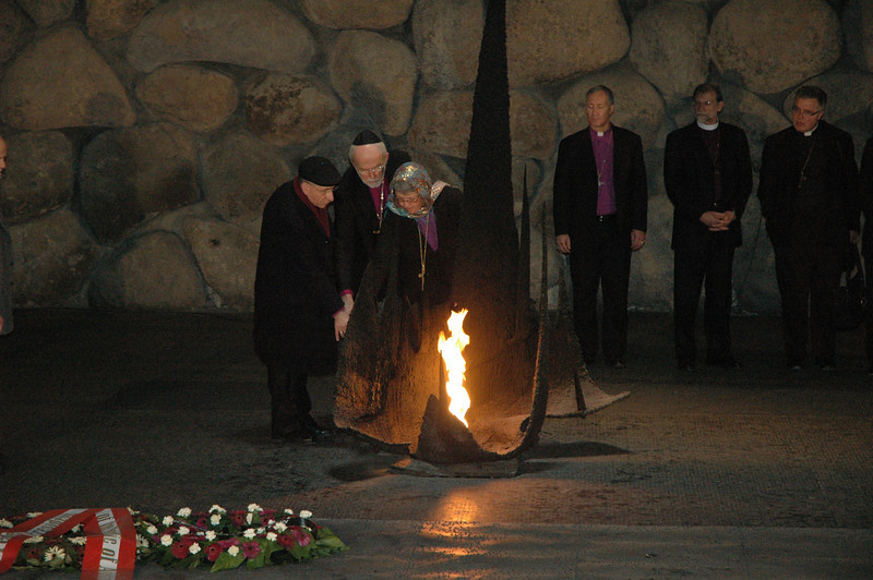 From left, ELCJHL Bishop Munib A. Younan, ELCA Presiding Bishop Mark Hanson and ELCIC National Bishop Susan Johnson light a symbolic eternal flame Jan. 8 at Yad Vashem, Jerusalem, a Holocaust memorial.