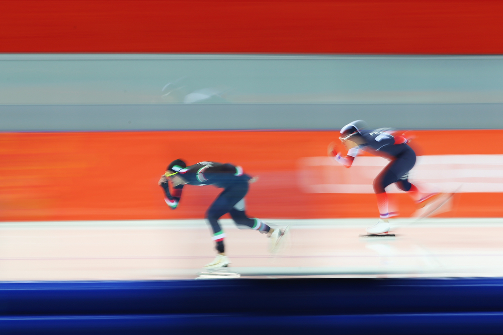 . Andrea Giovannini (L) of Italy and Ewan Fernandez of France compete during the Men\'s 5000m Speed Skating event during day 1 of the Sochi 2014 Winter Olympics at Adler Arena Skating Center on February 8, 2014 in Sochi, Russia.  (Photo by Quinn Rooney/Getty Images)