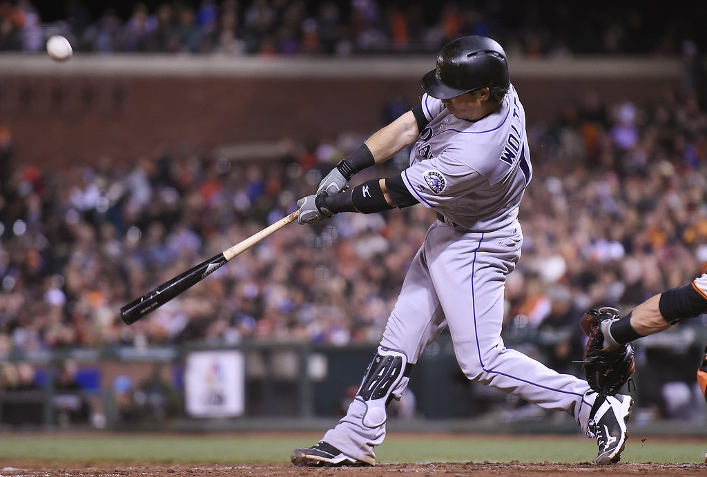 . SAN FRANCISCO, CA - MAY 05:  Tony Wolters #14 of the Colorado Rockies hits a bases loaded two-run rbi double against the San Francisco Giants in the top of the fifth inning at AT&T Park on May 5, 2016 in San Francisco, California.  (Photo by Thearon W. Henderson/Getty Images)
