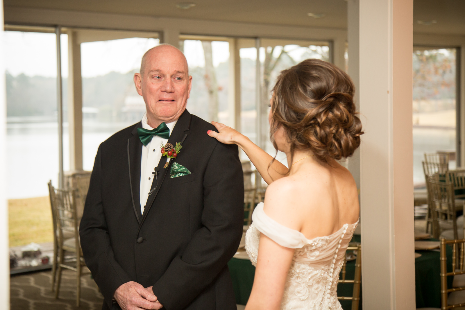 A father crying as he sees his daughter in her wedding dress for the first time