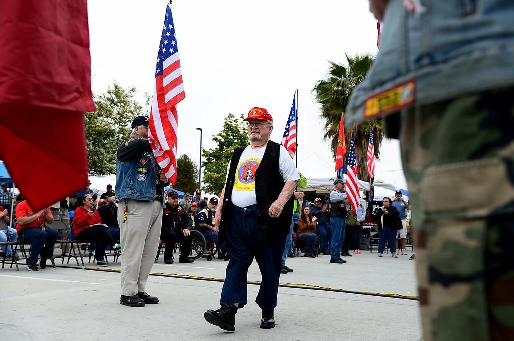 . Vietnam Veteran Leon Burns walks through the Patriot Guard Riders before receiving the Navy Cross during Jose Ramos\' annual Welcome Home Vietnam Veterans Day at California High School in Whittier Saturday, April 13, 2013.  (SGVN/Staff Photo by Sarah Reingewirtz)