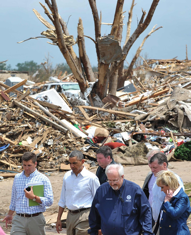 . US President Barack Obama tours a tornado affected area on May 26, 2013 in Moore, Oklahoma. Obama is in the Oklahoma City area to survey damage from the tornado which struck a week ago and to meet with victims and first responders.   MANDEL NGAN/AFP/Getty Images