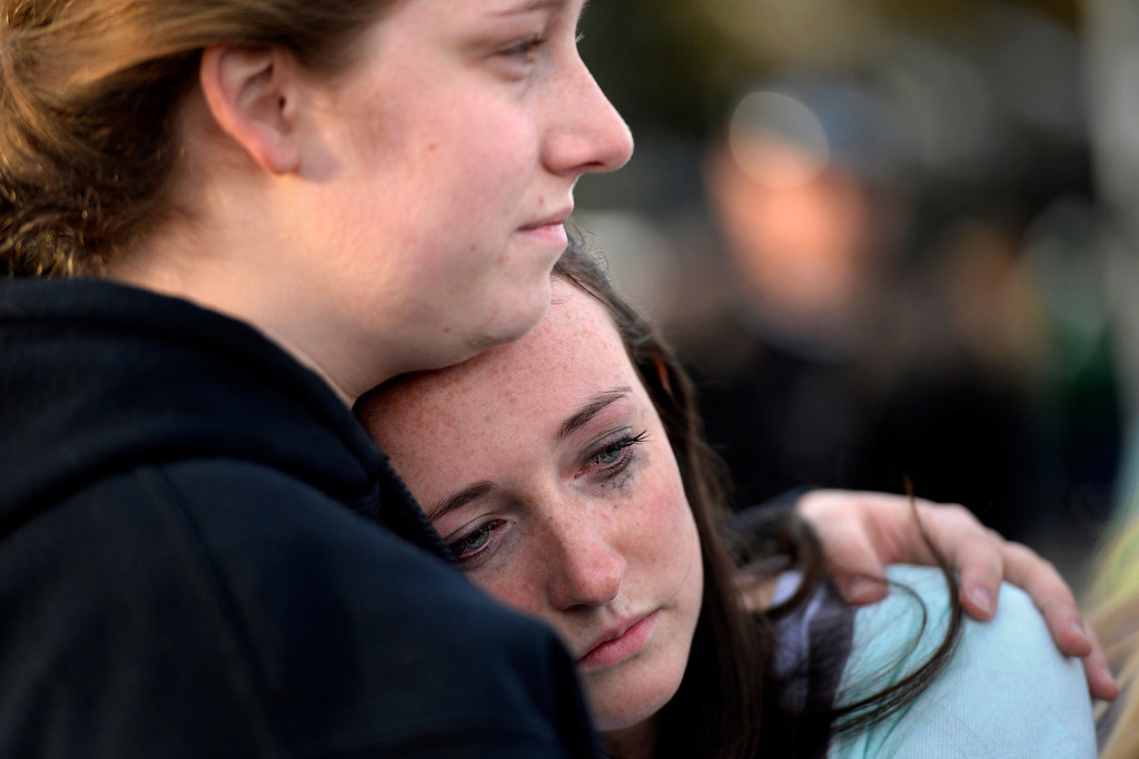 . CENTENNIAL, CO. - December 13: Jenni Meyers 17 year old senior is comforted by her older sister Mary Myers after being released from Shepherd of the Hills church during a lockdown when a student carried a shotgun into Arapahoe High School and opened fire on Friday, wounding two fellow students before apparently killing himself December 13, 2013 Centennial, CO. (Photo By Joe Amon/The Denver Post)