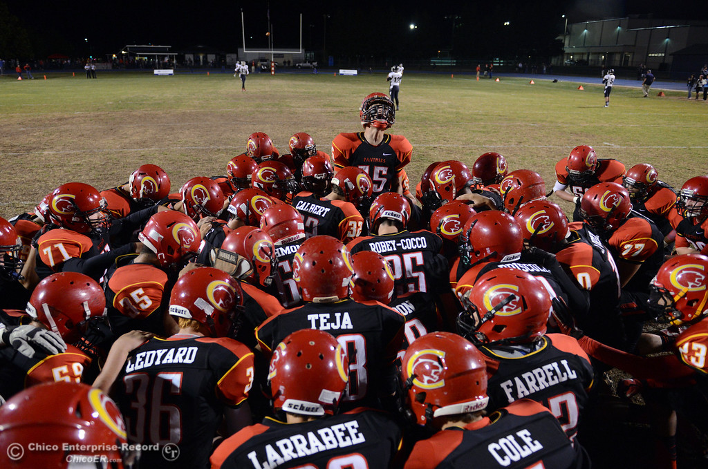 . Chico High\'s #15 Miles Fishback (top) readies the team against Central Valley High before the first quarter of their football game at Asgard Yard Friday, September 27, 2013, in Chico, Calif.  (Jason Halley/Chico Enterprise-Record)
