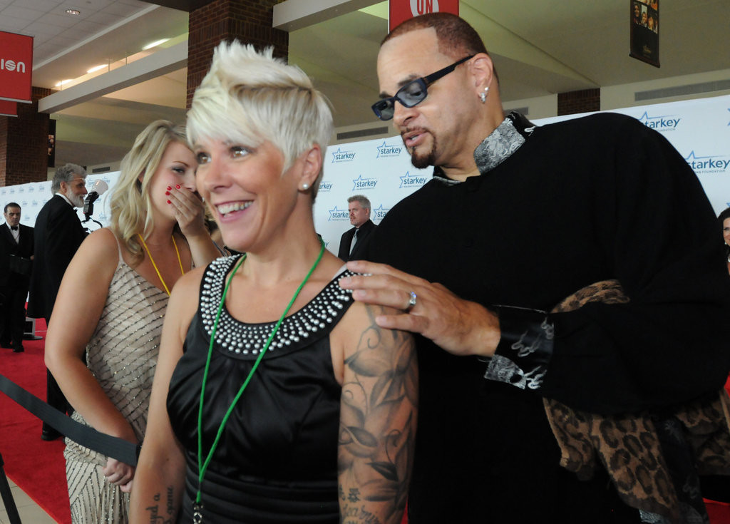 ". Missy Germain of Minneapolis, the owner of Wild Germ Productions, LLC., celebrity gossip blog ""Bitten and Bound,\"" shows off her tattoos to Sinbad. (Pioneer Press: Ginger Pinson)"
