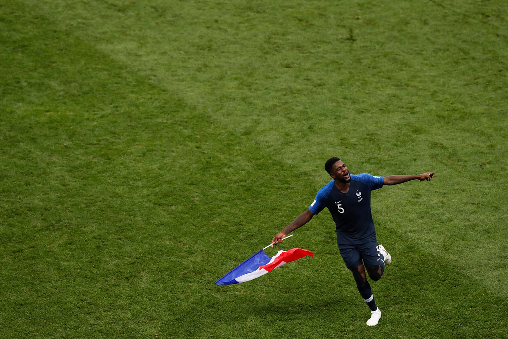 . France\'s Samuel Umtiti celebrates at the end of the final match between France and Croatia at the 2018 soccer World Cup in the Luzhniki Stadium in Moscow, Russia, Sunday, July 15, 2018. (AP Photo/Rebecca Blackwell)