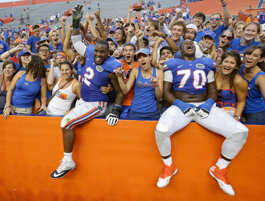 . Florida defensive lineman Dominique Easley (2) and offensive linesman D.J. Humphries (70) celebrate with fans after beating Tennessee 31-17 in an NCAA college football game in Gainesville, Fla., Saturday, Sept. 21, 2013.(AP Photo/John Raoux)