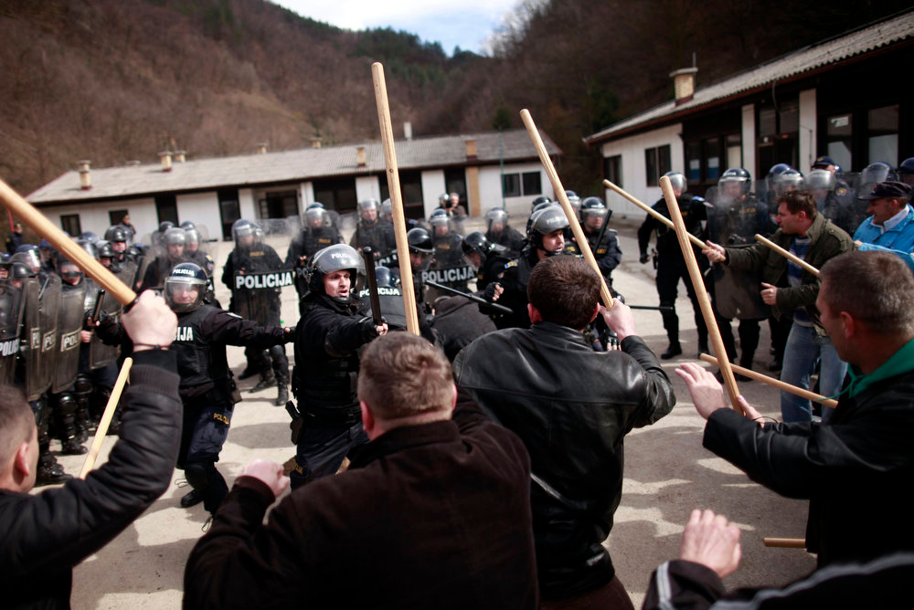 . Members of Special Police Force from the city of Zenica participate during an anti soccer hooligan exercise with people role-playing as demonstrators in Nemila, March 18, 2013. The local police organized a final exercise in preparation against soccer hooliganism for the upcoming World Cup qualifier soccer match between Greece and Bosnia on March 22. According to local medai, local police are anticipating violence which may arise among Serbian supporters, who support the Greek team, and Bosnian fans. REUTERS/Dado Ruvic