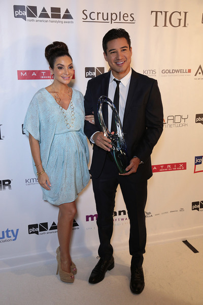 Mario Lopez with the Professional Beauty Association's Beautiful Humanitarian Award with wife Courtney at the 2013 NAHAs
