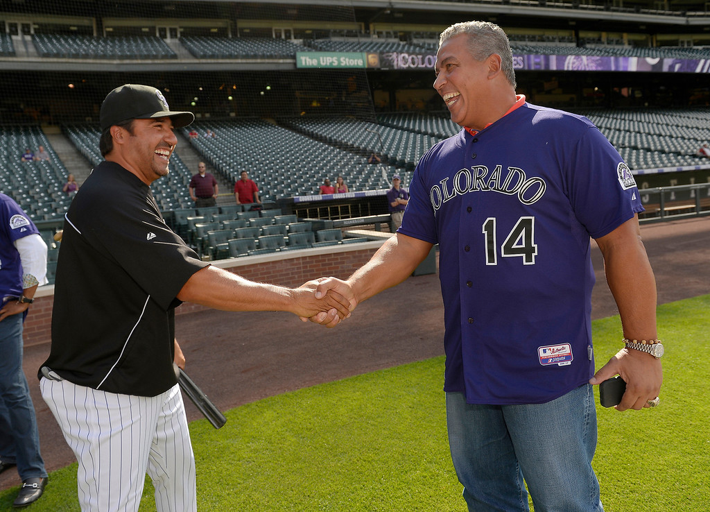 . Colorado Rockies Vinny Castilla (L) shares a laugh with Andres Galarraga during an open workout session for the fans July 18, 2013 at Coors Field. (Photo By John Leyba/The Denver Post)