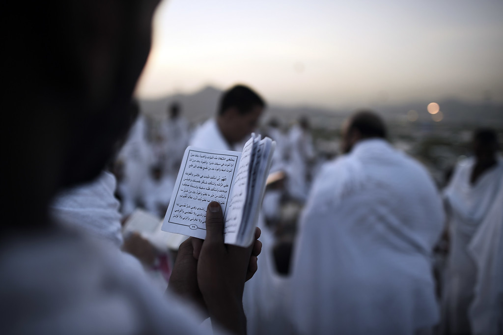. Muslim pilgrims gather on Mount Arafat near Mecca as they perform one of the Hajj rituals late on October 3, 2014. The pilgrims perform a series of rituals during the annual Hajj. They circumambulate the kaaba seven times, runs back and forth between the hills of Al-Safa and Al-Marwah, drink from the Zamzam Well, goes to the plains of Mount Arafat to stand in vigil, and throws stones in a ritual Stoning of Devil. The pilgrims then shave their heads, perform a ritual of animal sacrifice, and celebrate Eid al-Adha holiday. MOHAMMED AL-SHAIKH/AFP/Getty Images