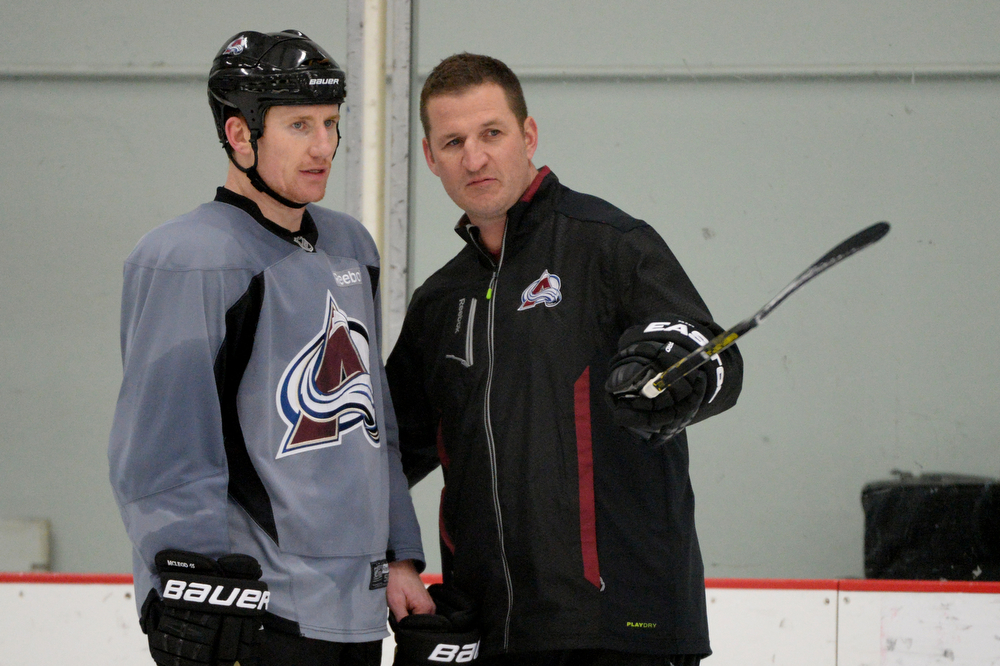 . Defense Development Consultan Adam Foote, right, is talking to Cody McLeod of Colorado Avalanche (55) during the team practice for the the first round of the playoff game against Minnesota Wild at Family Sports Center. Centennial, Colorado. April 15. 2014. (Photo by Hyoung Chang/The Denver Post)