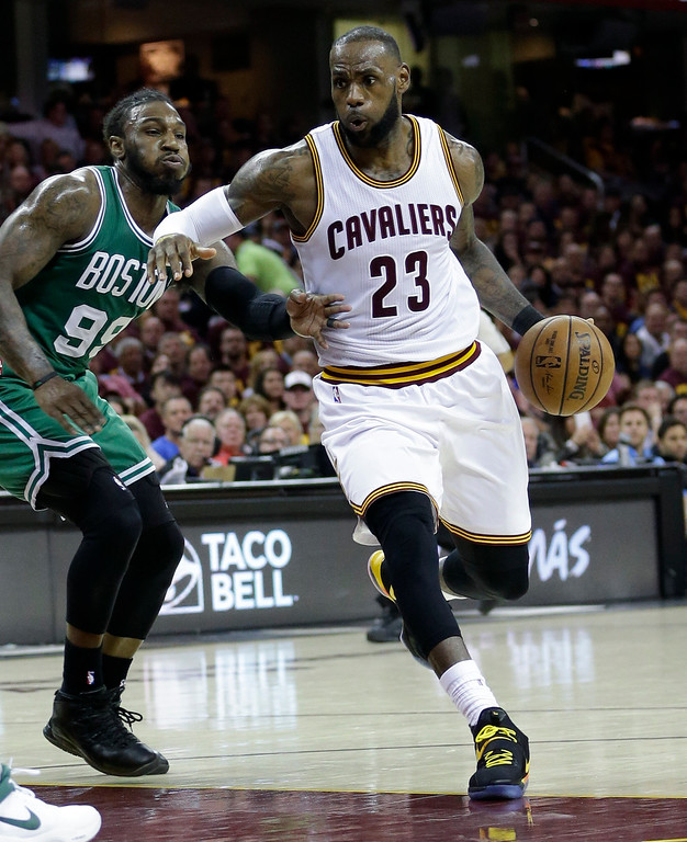 . Cleveland Cavaliers\' Kyrie Irving (2)3 drives on Boston Celtics\' Jae Crowder (99) during the second half of Game 3 of the NBA basketball Eastern Conference finals, Sunday, May 21, 2017, in Cleveland. (AP Photo/Tony Dejak)