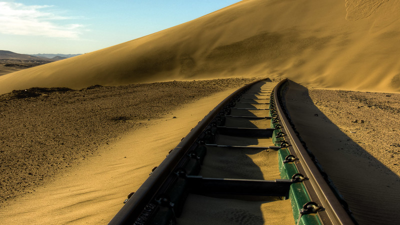 Rapidly moving sand dunes, covers the new track.