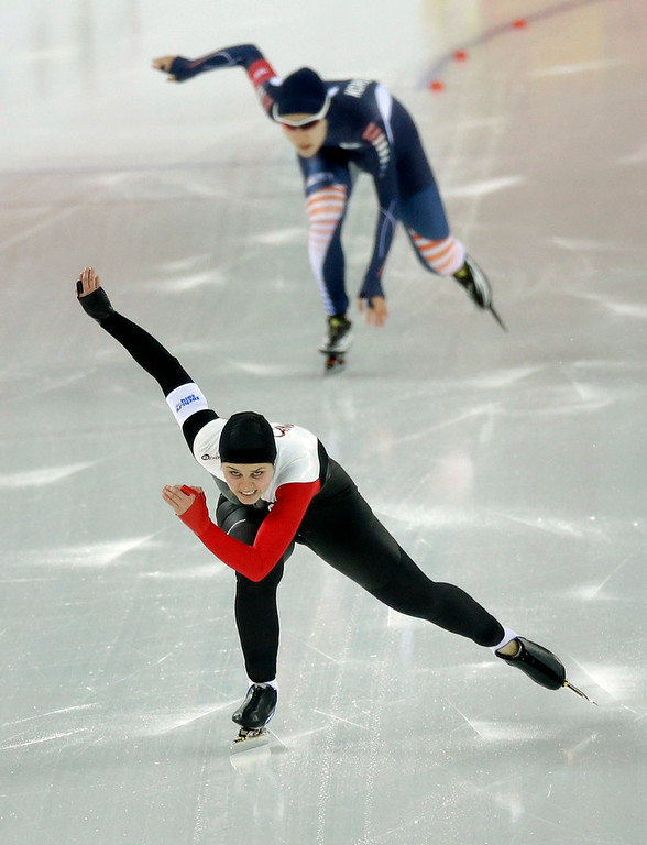 . Canada\'s Marsha Hudey, foreground, and South Korea\'s Kim Hyun-yung compete in the first heat of the women\'s 500-meter speed skating race at the Adler Arena Skating Center during the 2014 Winter Olympics, Tuesday, Feb. 11, 2014, in Sochi, Russia. (AP Photo/David J. Phillip )