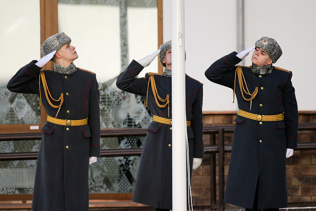 . Members of a Russian honor guard salute during a welcome ceremony for the Brazilian Olympic team at the Mountain Olympic Village  in Krasnaya Polyana, Russia, prior to the 2014 Winter Olympics, Tuesday, Feb. 4, 2014. (AP Photo/Jae C. Hong)