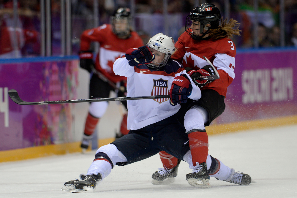 . Jocelyne Larocque (3) of the Canada takes Jocelyne Lamoureaux (17) of the U.S.A. to the ice during the third period of the women\'s gold medal ice hockey game. Sochi 2014 Winter Olympics on Thursday, February 20, 2014 at Bolshoy Ice Arena. (Photo by AAron Ontiveroz/ The Denver Post)