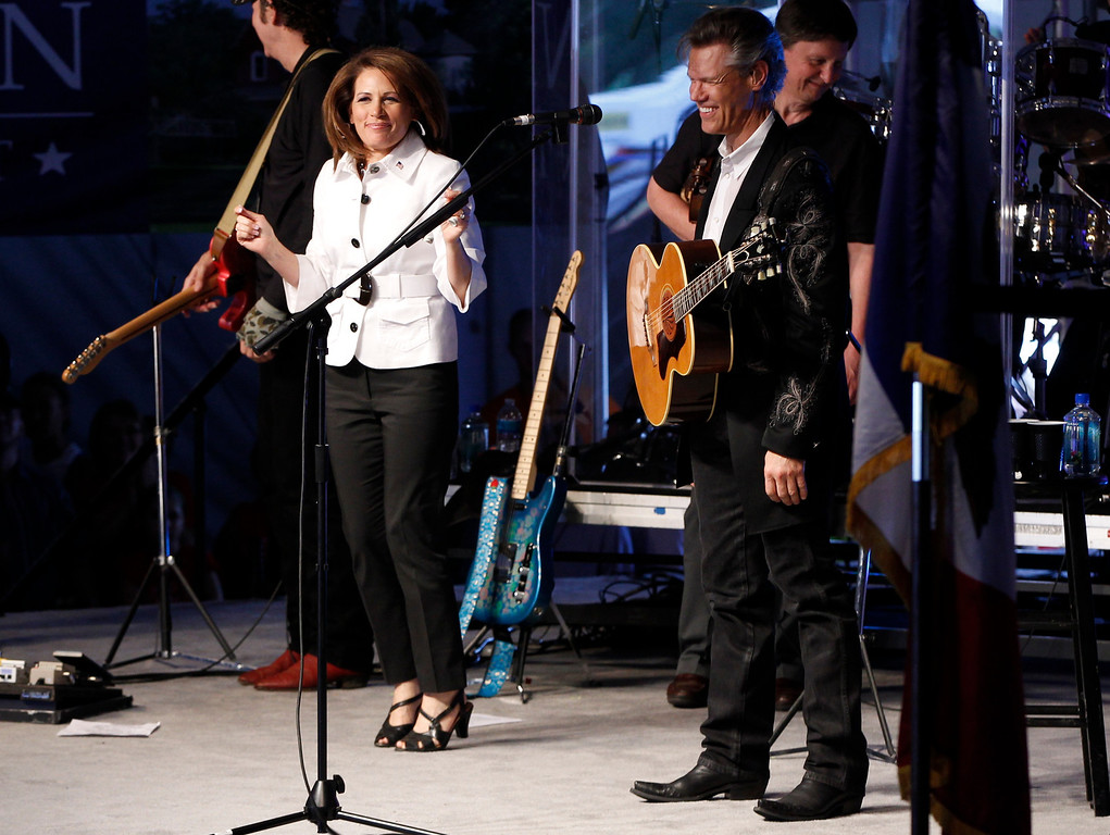 . Republican presidential candidate Rep. Michele Bachmann, R-Minn., is pictured on stage with singer Randy Travis at the Republican Party\'s Straw Poll in Ames, Iowa, Saturday, Aug. 13, 2011. (AP Photo/Charles Dharapak)