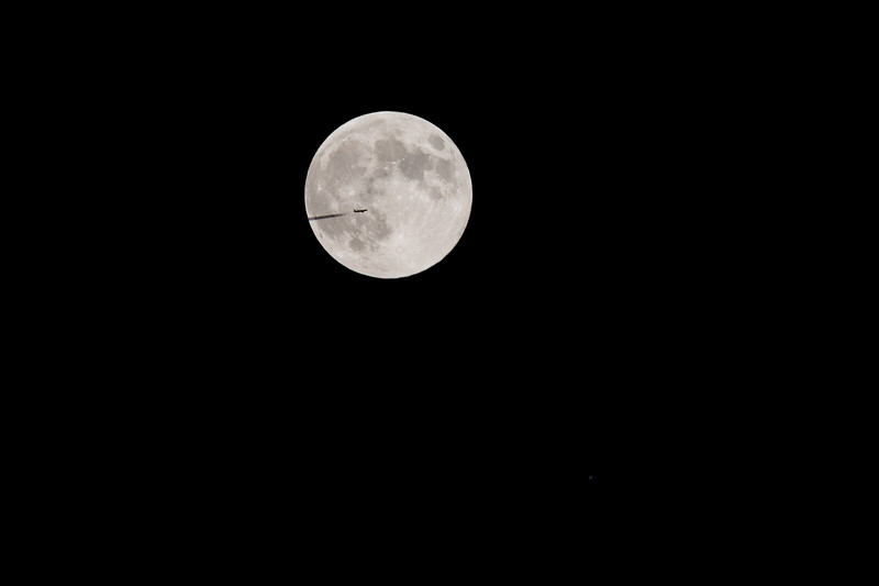Airplane Transits the Strawberry Moon with Saturn Below
