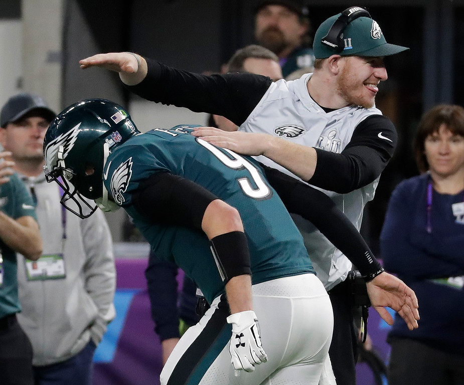 . Philadelphia Eagles\' Carson Wentz, right, congratulates Nick Foles after throwing a touchdown pass to Corey Clement during the second half of the NFL Super Bowl 52 football game against the New England Patriots Sunday, Feb. 4, 2018, in Minneapolis. (AP Photo/Mark Humphrey)
